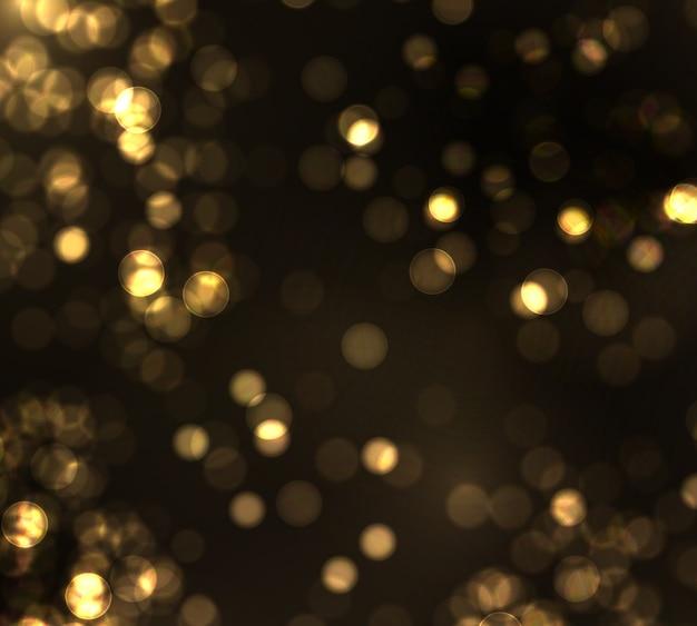 ゴールドのボケは、黒い背景にぼやけた光。黄金色のライトと年末年始のテンプレート。抽象的なキラキラデフォーカス点滅星と火花。 Premiumベクター