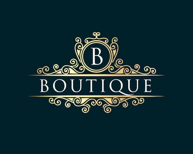 ゴールド書道フェミニンな花の手描きの紋章モノグラムアンティークビンテージスタイルの高級ロゴデザインホテルレストランカフェコーヒーショップスパビューティーサロン高級ブティック化粧品 Premiumベクター