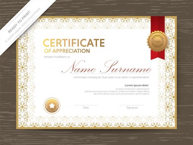 古典的な花のボーダーとフレームのゴールド証明書賞の卒業証書のテンプレート Premiumベクター