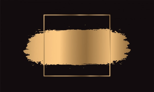 Gold paint brush strokes. frame golden on black background. Premium Vector