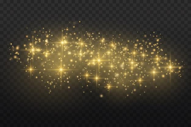 金色の火花と金色の星が特別な光の効果を輝きます。透明な背景の上で輝きます。クリスマスの要約。ほこり。 Premiumベクター