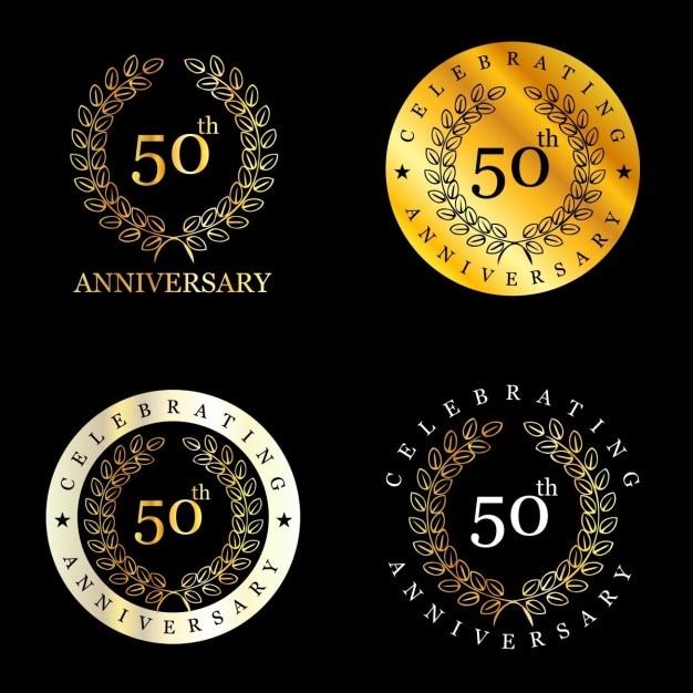 Golden 50 years badges with laurel wreath Free Vector