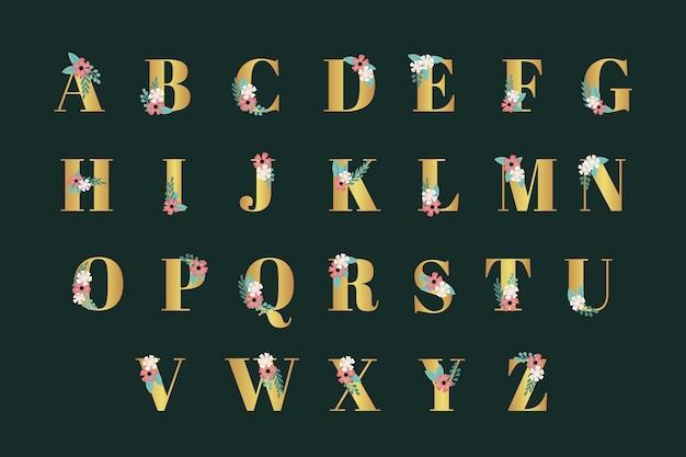 Golden alphabet with elegant flowers for wedding Free Vector
