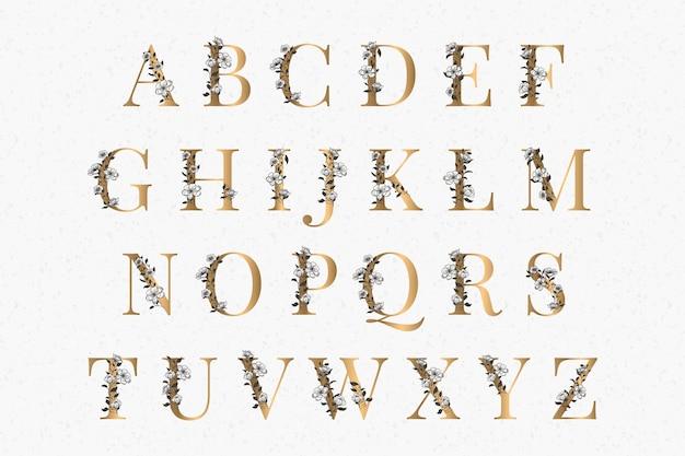Golden alphabet with elegant flowers Free Vector
