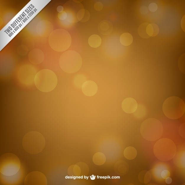 Golden blurred abstract background Premium Vector