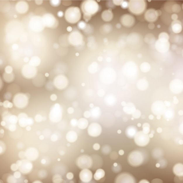 Golden bokeh background Free Vector