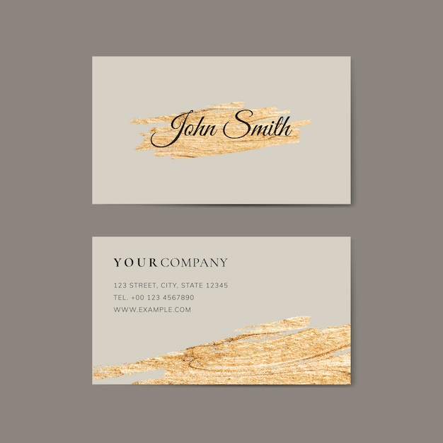 Golden brush stroke on a business card template Premium Vector