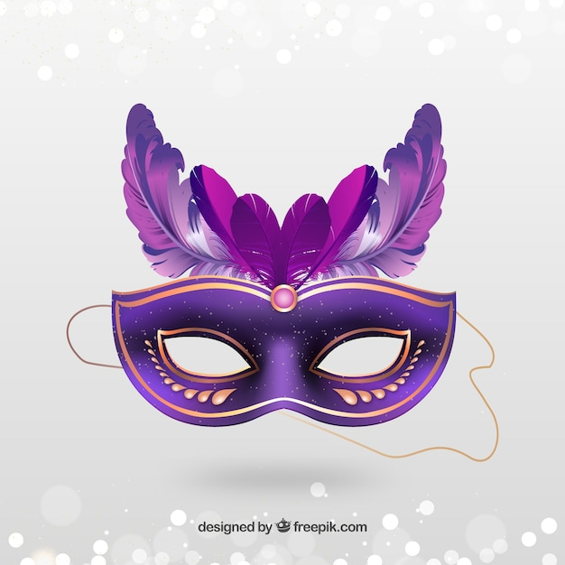 Golden carnival mask with pink feathers Free Vector
