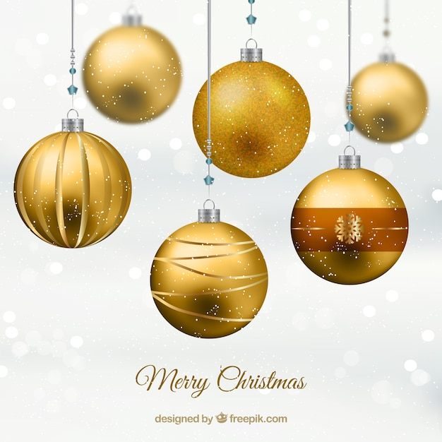 Golden christmas balls Free Vector