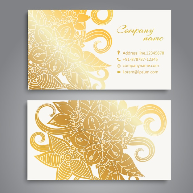 Golden flowers on white background business\ card design
