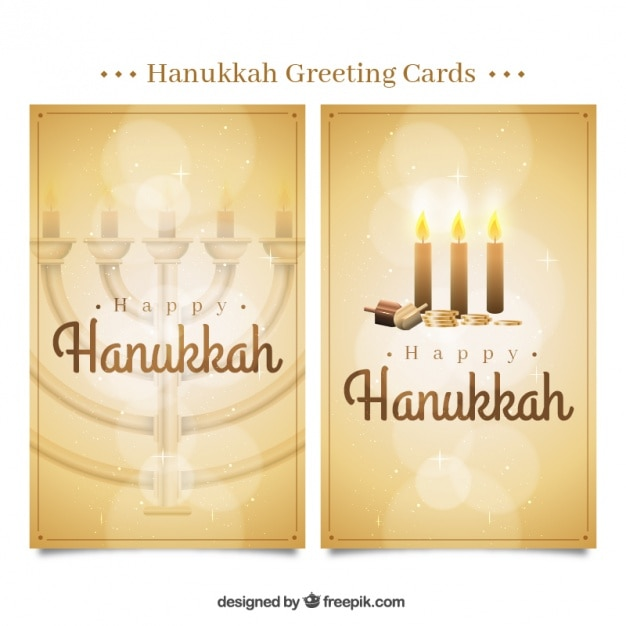 Golden hanukkah greeting cards with bokeh\ effect
