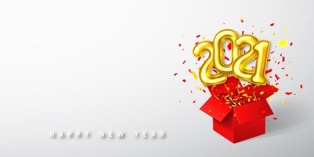 赤い箱と紙吹雪から飛んでいる黄金のヘリウム気球番号 Premiumベクター
