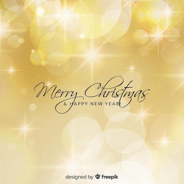 Golden lights christmas background Free Vector