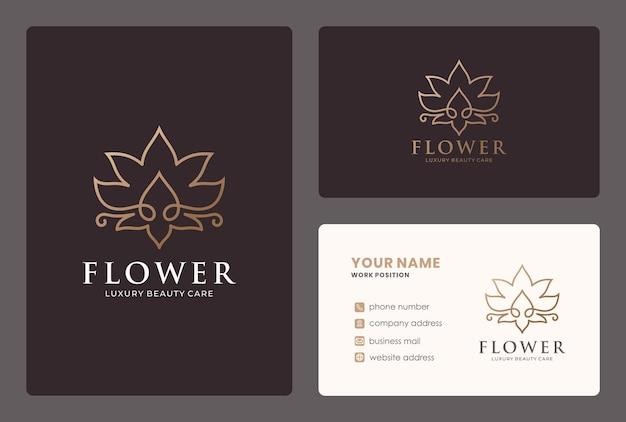 サロン、スパ、ヨガ、ウェルネス、マッサージ、美容ケアのためのゴールデンライン蓮の花のロゴ。 Premiumベクター