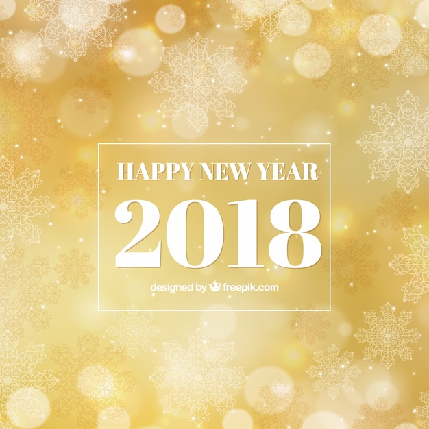 golden new year background with bokeh effect free vector