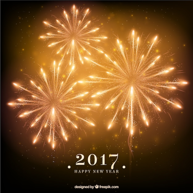 Golden new year fireworks background Vector | Free Download