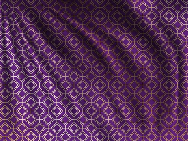 Golden oriental pattern on wavy silk fabric Premium Vector