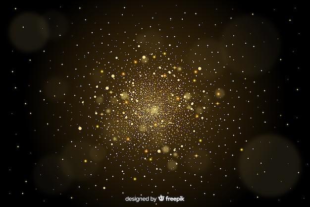 黄金の粒子がぼやけて装飾的な背景 無料ベクター
