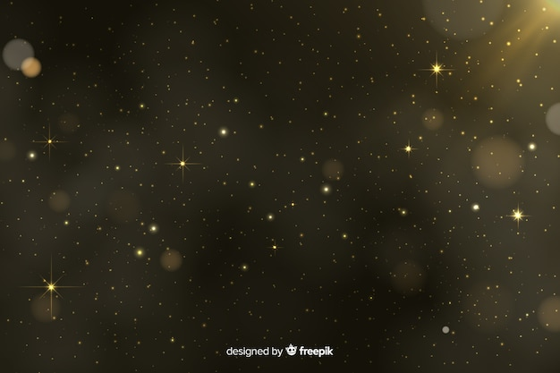 Golden particles bokeh background Free Vector