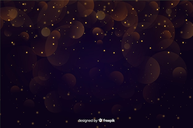 Golden particles bokeh on dark background Free Vector
