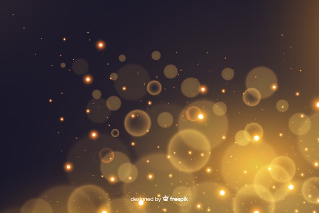 Golden particles bokeh decorative background Free Vector