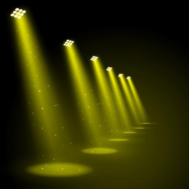 Golden spotlights shining background Premium Vector
