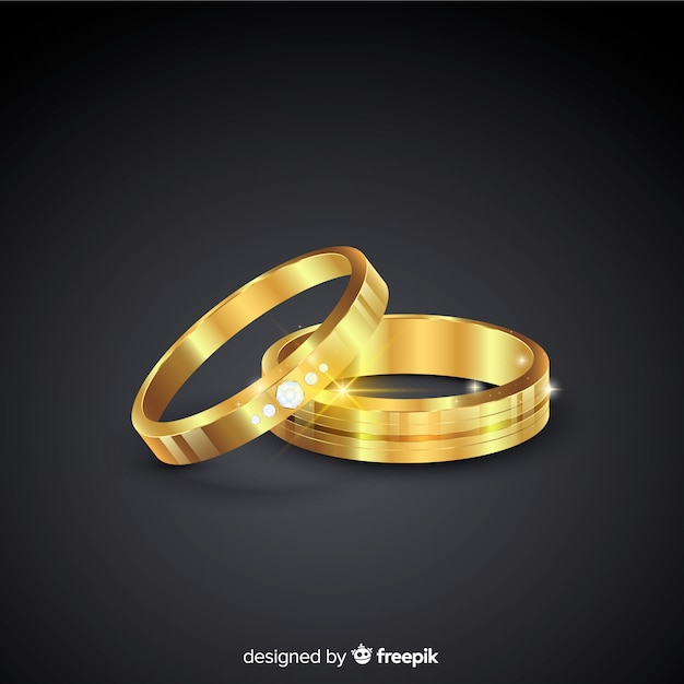 Golden wedding rings in realistic style Free Vector