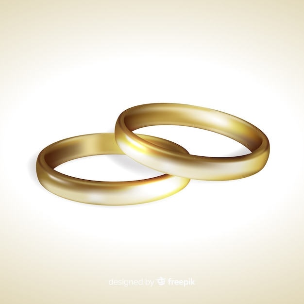 Golden wedding rings realistic style Free Vector