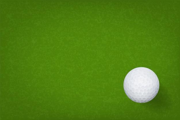 Golf ball on green grass texture background. Premium Vector