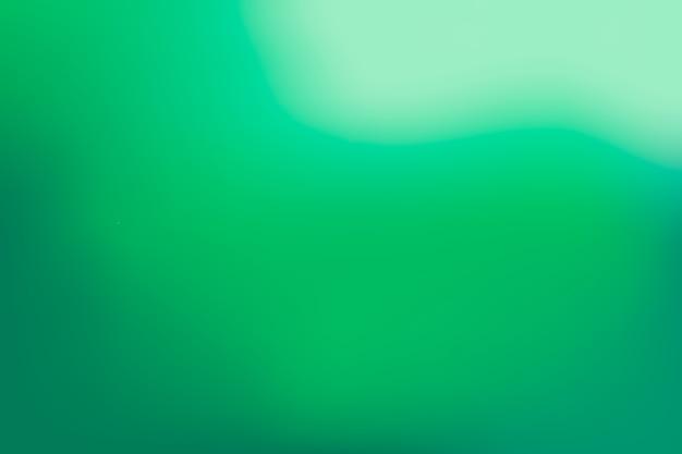 Gradient background in green tones Free Vector