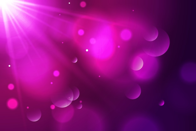 Gradient background with bokeh effect Free Vector