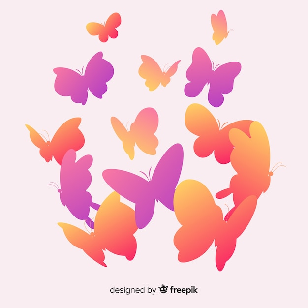 Gradient butterflies silhouettes background Free Vector