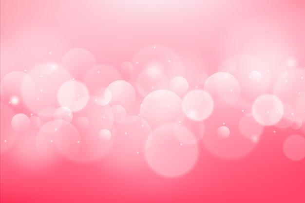 Градиентный розовый фон с эффектом боке Premium векторы