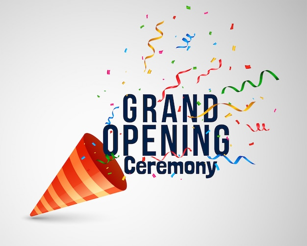 Grand opening ceremony lettering with confetti and cap Free Vector