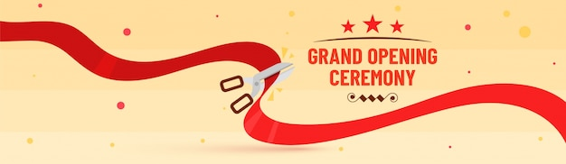 Grand opening ceremony text and scissor cutting ribbon. Premium Vector