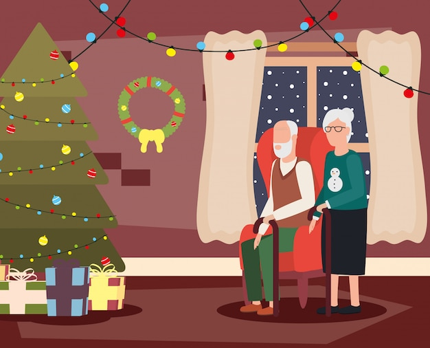 Grandparents couple in living room with christmas decoration Free Vector