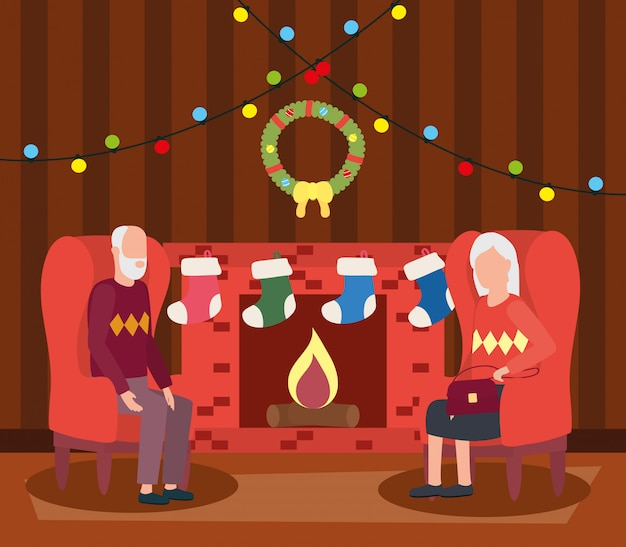 Grandparents couple in livingroom with christmas decoration Free Vector