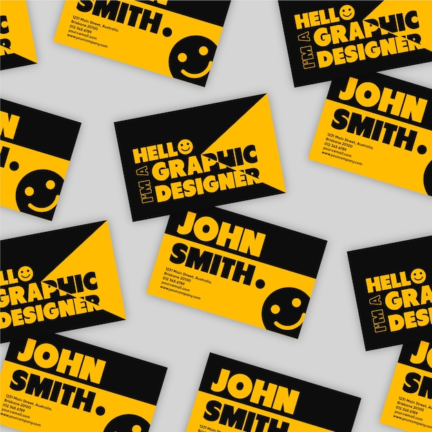 Graphic designer business card in black and orange with smiley face Free Vector