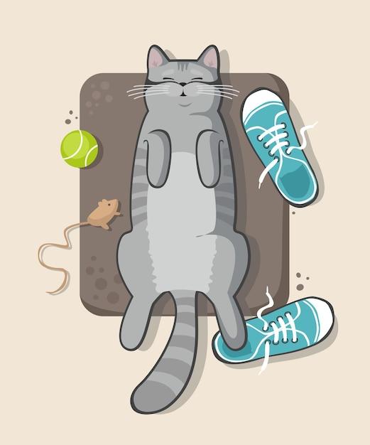 Серый кот спит на полу в кроссовках Premium векторы