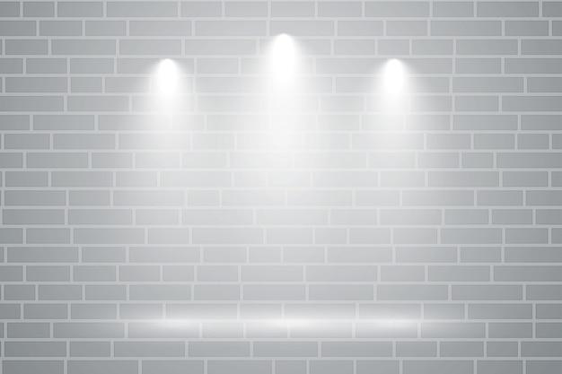 Muro grigio con tre luci di messa a fuoco che cadono su di esso Vettore gratuito