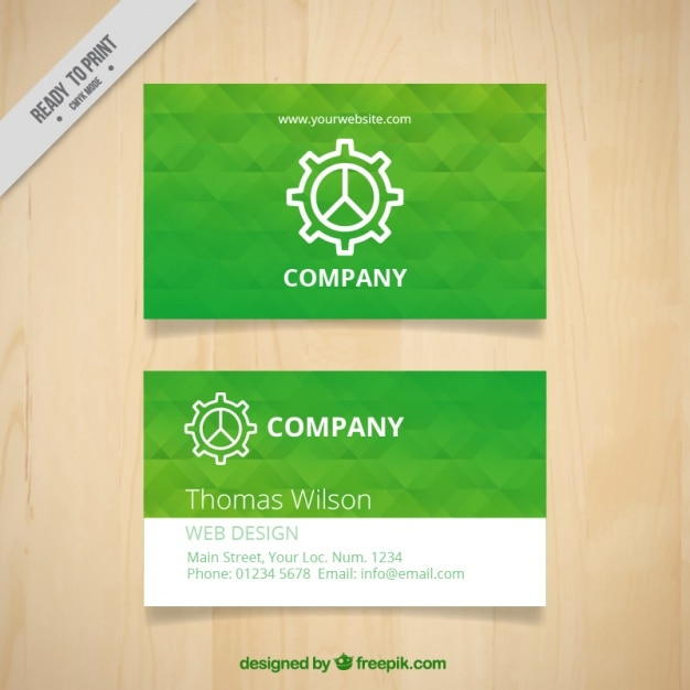Green business card template with geometric shapes