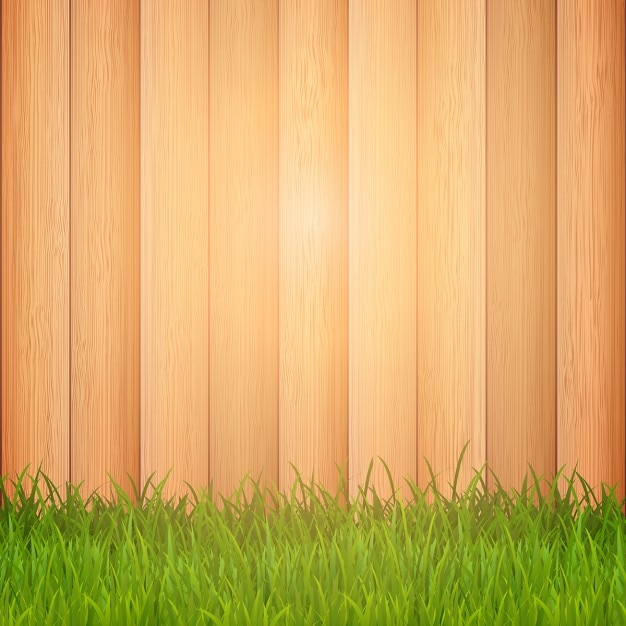 Green grass on a wooden background