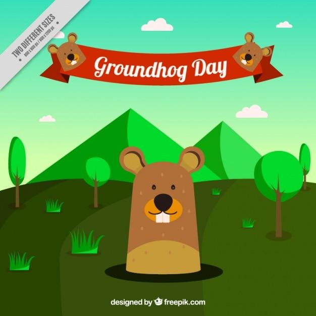 Green landscape background with\ groundhog