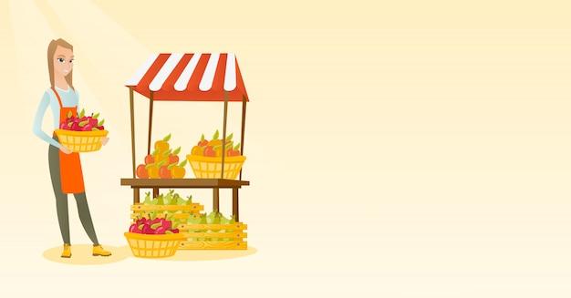 Greengrocer holding box full of apples. Premium Vector