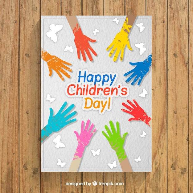 Greeting card children\'s day with colors\ painted hands