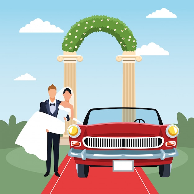 Groom holding bride in his arms and red classic car in just married scenery Premium Vector