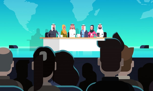 Group of arab business people on conference public debate interview concept official meeting of arabic politicians in front of big audience Premium Vector