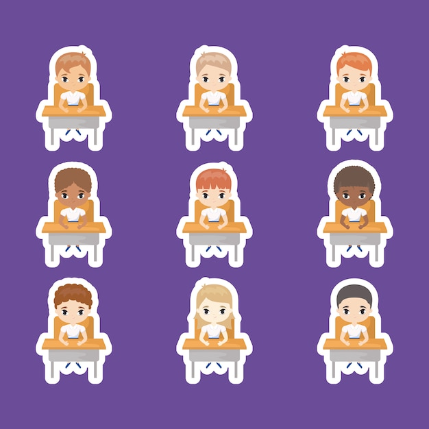 Group of cute little students seated in school desks Premium Vector