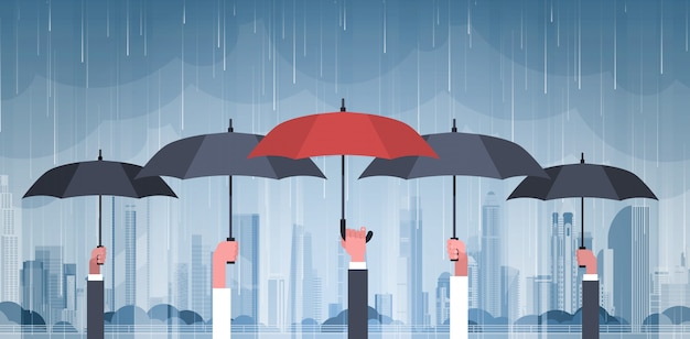 Group of hands holding umbrellas over storm in city huge rain background hurricane tornado in town natural disaster concept Premium Vector