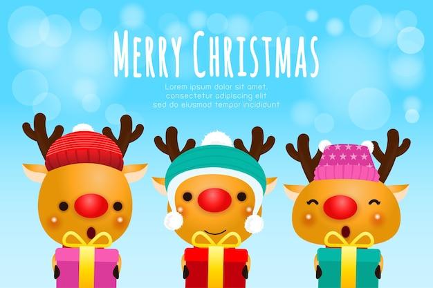 Группа счастливых оленей в рождественских шапках и подарках Premium векторы